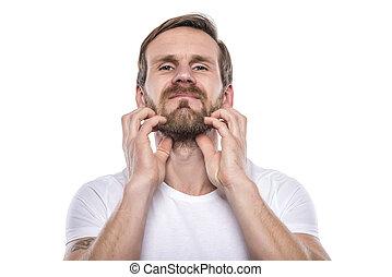 Adult male scratching beard. - Adult male scratching beard...