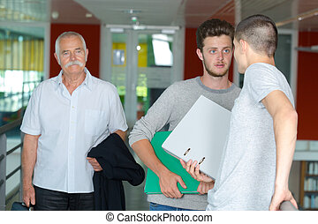 adult male students talking at a university