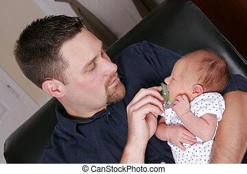 adult man and newborn baby