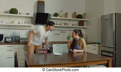 Adult man and woman arguing in domestic kitchen - Tired wife...