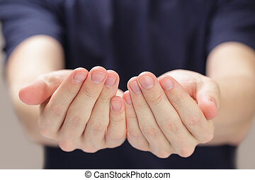 adult man cupped hands showing something