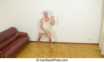 adult man dances at home, 4k.