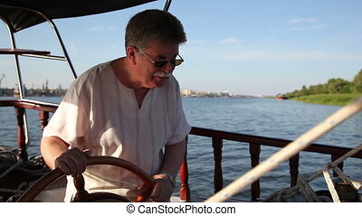 adult man driving a boat 2