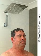 Adult man having a shower