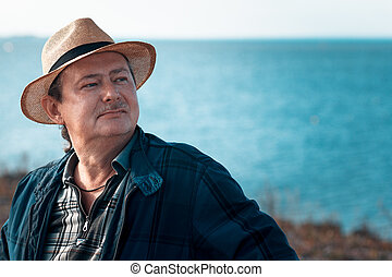 Adult man in a straw hat