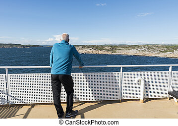 adult man in blue sweater on ferry
