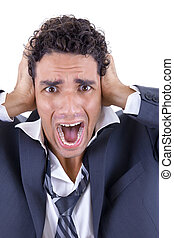 adult man in suit holding his head and screaming