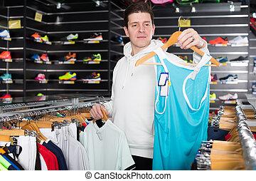 Adult man is choosing tennis T-shirt