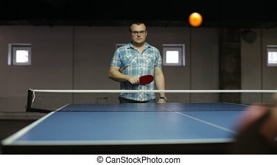 Adult man playing table tennis