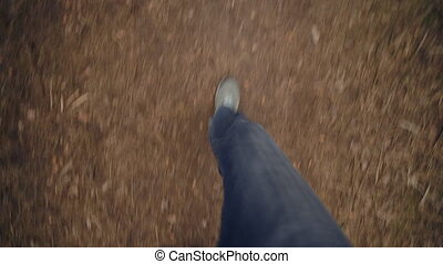 Adult man POV of his boots from top to bottom and walking on the mud ground