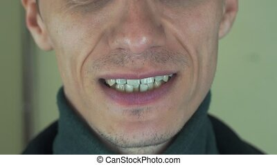 Adult man pronounce words in front camera. Mouth. Teeth. Bristle. Smiling.