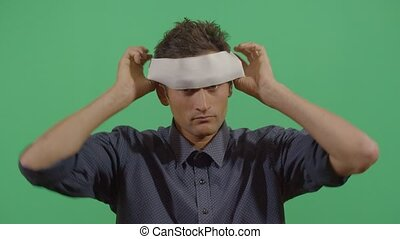 Adult Man Putting On A Blindfold Like Hiding From The World In Ecuador