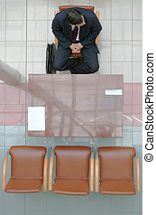 Adult man sitting on the chair and waiting for interview - 2
