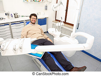 Adult man smiling in dental surgery
