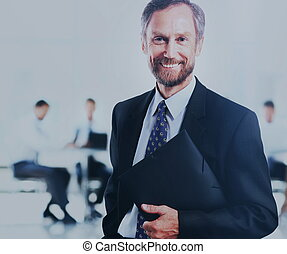 adult man smiling looking at the camera with a folder in his hands