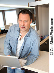 Adult man surfing on internet at home