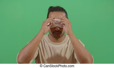 Adult Man Being Prepared To See Something For The First Time Like A Present. Studio Isolated Shot Against Green Screen Background
