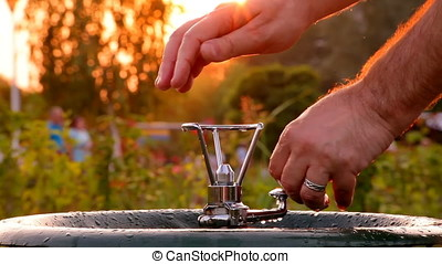 Adult Man Washing Hands In Bubbler