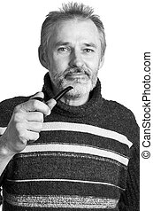 adult man with a pipe in a hand