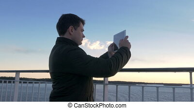 Adult Man With Tablet On Cruise Ship