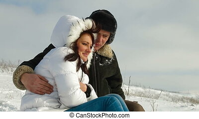 married couple enjoying a winter