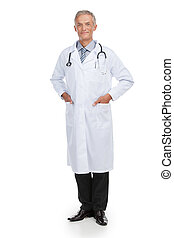 Adult nice looking doctor looking at camera. Standing isolated on white background