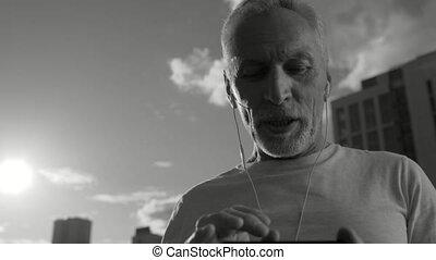 Adult pleasant man talking via smart phone - Nice to hear...