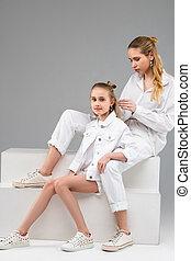 Pleasant peaceful girl leaning on her elder sister - Adult ...