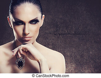 Adult pretty woman stylish portrait. Skin texture saved