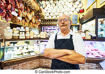 adult seller portrait in butcher store