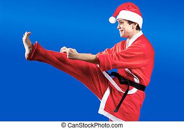 Adult sportswoman in a suit of Santa Claus hits a kick leg