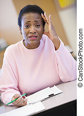 Adult student in class looking frustrated