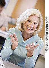 Adult student in class smiling (selective focus)