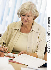 Adult student studying at table