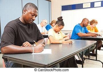 Adult Students Taking Test - Class of adult college students...