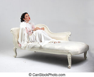 Adult tan woman on sofa