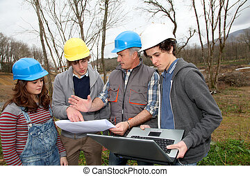 Adult with group of teenagers in professional training