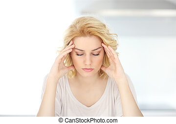 Adult woman having headache at home
