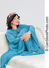 Adult woman in blue abaya