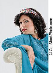 Adult woman in blue abaya