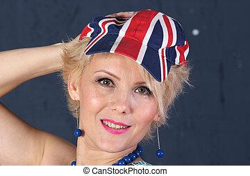 Adult woman in union jack cap