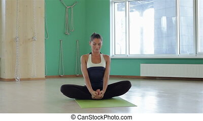 Adult woman in yoga position
