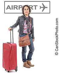 adult woman is traveling. Woman with a suitcase goes to airport