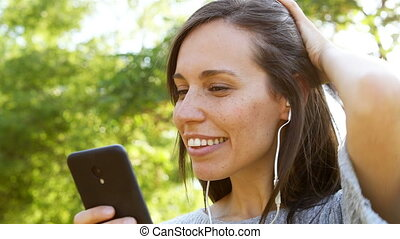 Adult woman listening to music on phone - Happy adult woman...