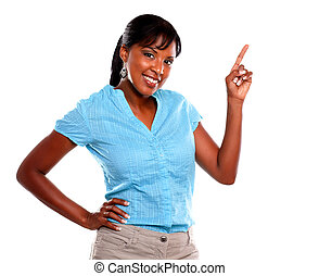 Adult woman looking at you and pointing up