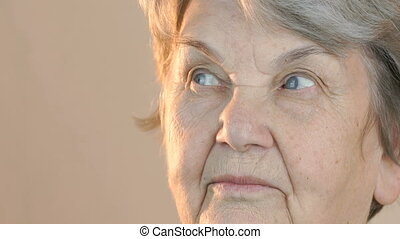 Adult woman looking in side. Face close up - Adult woman...