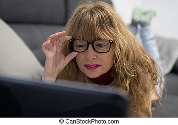 adult woman on the sofa with laptop