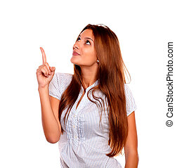 Adult woman pointing and looking up copyspace