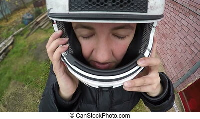 Adult Woman Putting On Her motorcycle Helmet, happy face, extreme adventures adrenaline