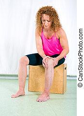 Adult woman rehabilitating injured leg
